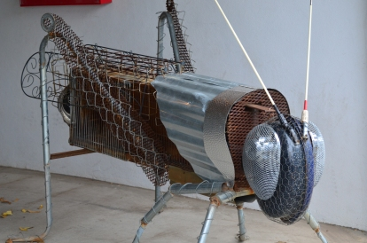 Giant grasshopper out of reclaimed metal