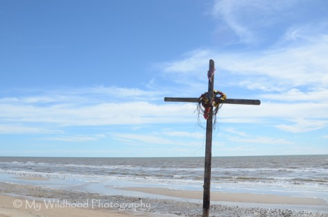 Cross on the beach - I'm not sure, but I think this is related to Hurricane Ike from 2008.
